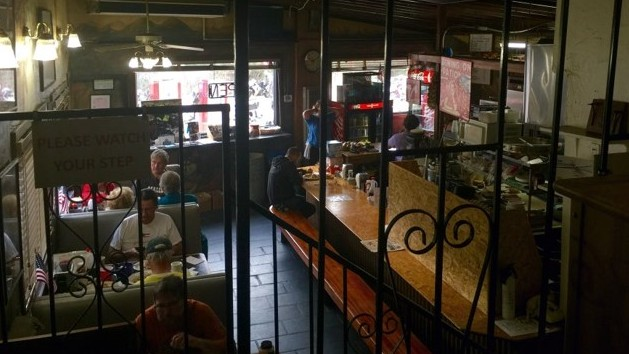 Inside The Rock Store guests find rustic 1960's style booths and a lunch counter