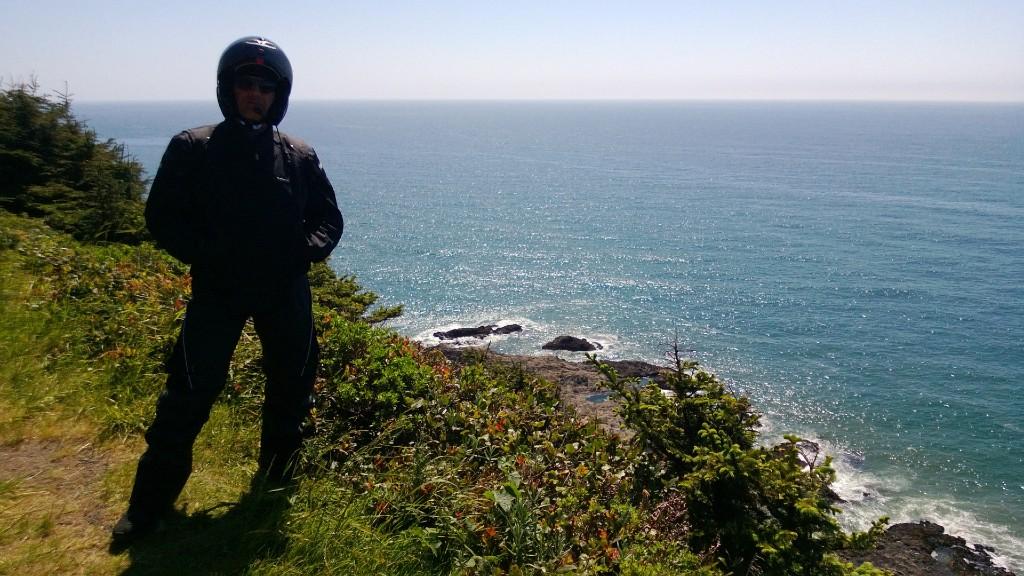 Rider overlooking Pacific ocean