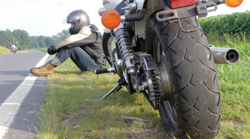 Motorcyclist stranded on roadside.