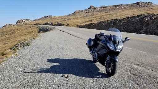 Sport Tourer on a pullout looking up to the summit of Beartooth Pass