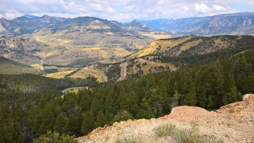 The hills and trees take vivid pastel colors across the valley below Dead Indian Pass on Chief Joseph Highway