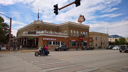 The brown brick two story Irma Hotel building on a corner of main street in Cody WY