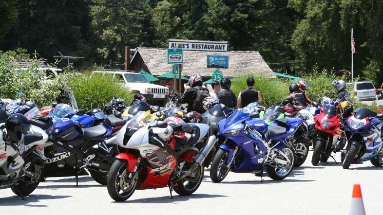 an assortment of colorful sportbikes in front of Alice's Restaurant